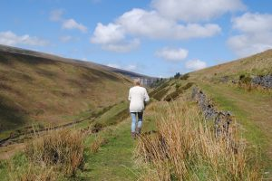Wilma walking and wondering near Grwyne Fawr Dam, Black Mountains